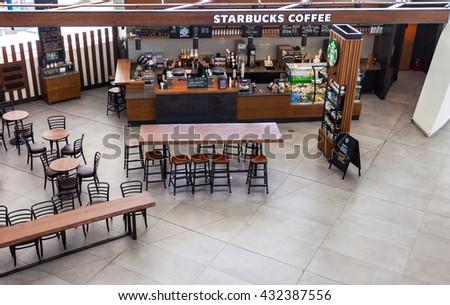 SAMARA, RUSSIA - MAY 22, 2016: Starbucks cafe in Samara Kurumoch airport. Starbucks Corporation is an American global coffee company and coffeehouse chain - stock photo