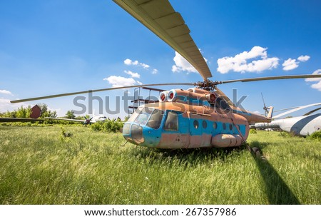 SAMARA, RUSSIA - MAY 25, 2014: The russian transport helicopter Mi-6 at an abandoned aerodrome. The Mil Mi-6 was built in large numbers for both military and civil roles - stock photo