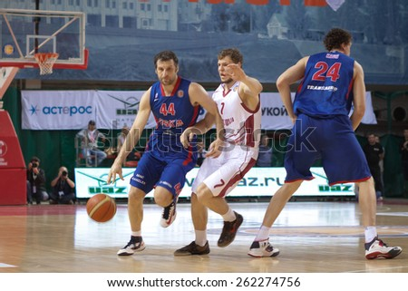 SAMARA, RUSSIA - MAY 20: Theodoros Papaloukas of BC CSKA with ball tries to go past a BC Krasnye Krylia player on May 20, 2013 in Samara, Russia. - stock photo