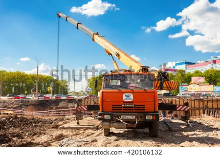 SAMARA, RUSSIA - MAY 7, 2016: Truck crane KAMAZ working at the construction site under construction of road