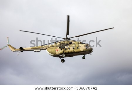 SAMARA, RUSSIA - NOVEMBER 4, 2015: Russian army Mi-8 helicopter in action against cloudy sky - stock photo