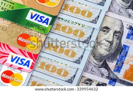 SAMARA, RUSSIA - NOVEMBER 15, 2015: US dollar bills with credit cards Visa and MasterCard - stock photo