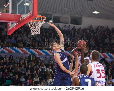 SAMARA, RUSSIA - OCTOBER 22: Julian Wright of BC Krasnye Krylia, with ball, is on the attack during a BC Triumph game on October 22, 2013 in Samara, Russia. - stock photo