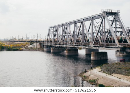 Samara, Russia - Septenber 30, 2016: A train on the railway bridge
