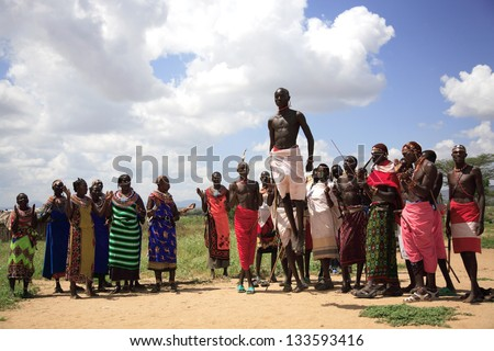 SAMBURU, KENYA, AFRICA - JAN 20, 2013: People from a local village located in Samburu National Park perform a traditional dance for tourists. - stock photo