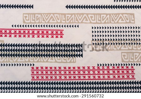 Samoan cloth fragment with red, black,and tan designs against a faded white background. - stock photo