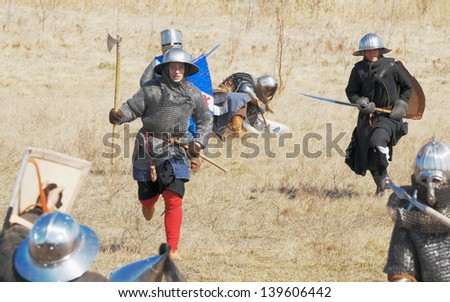 SAMOLVA, RUSSIA - APRIL 22: historical reconstruction of the Battle on the Ice, member(s) dressed in medieval armor on April 22, 2012 in village Samolva near Pskov, Russia.