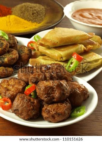 Samosas, bhajis and pakoras with dip and spices - stock photo