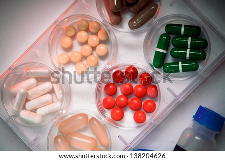 Samples of medicines, tablets, capsules, vitamins, and placebo