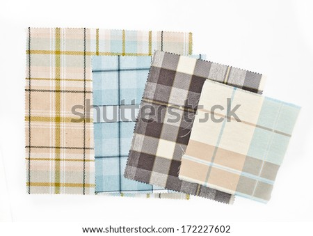 Samples of tartan fabric on a whiite background