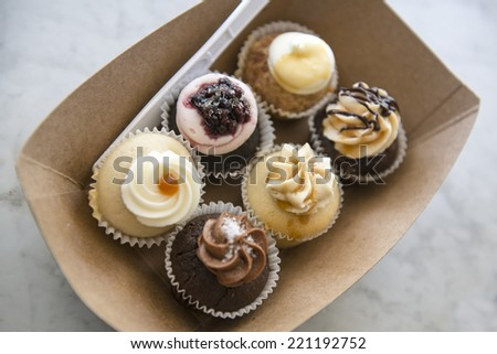 Sampling of mini cupcakes - stock photo