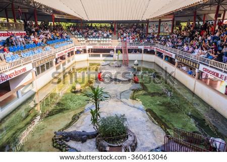 SAMUT PRAKAN, THAILAND - December 27,2015: The crocodile show at Samut Prakan Crocodile Farm and Zoo. - stock photo
