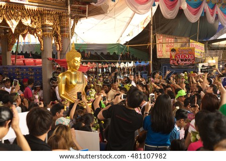SAMUT PRAKAN,THAILAND â?? OCTOBER 26,2015 : Unidentified peoples enjoy carrying Buddha statue from the boat on End of Buddhist Lent Day in Rub Bua Festival ,Samut Prakan Province, Middle of Thailand.