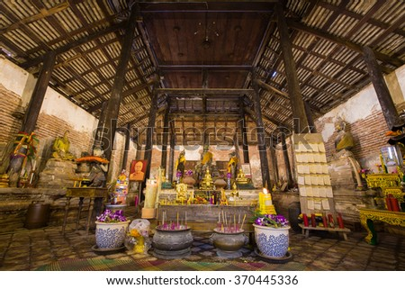 SAMUT SAKHON, THAILAND - SEPTEMBER 25: Interior of old church of Thai temple with Buddha statues and altar on September 25,2015 in Wat Yai Ban Bo.