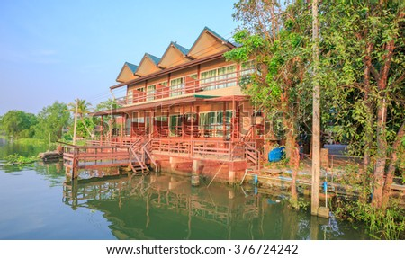"SAMUT SONGKHAM - FEB,15 : The wood house resort in Thai style located beside the main river named "" MAE KLONG"" river that have many tourists visiting here everyday. THAILAND FEB,15 2016"