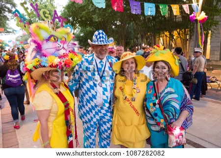 San Antonio, Texas - April 19, 2018: Elected royalty of the past poses for pictures during the opening night celebration of Fiesta San Antonio during the city's tricentennial year.