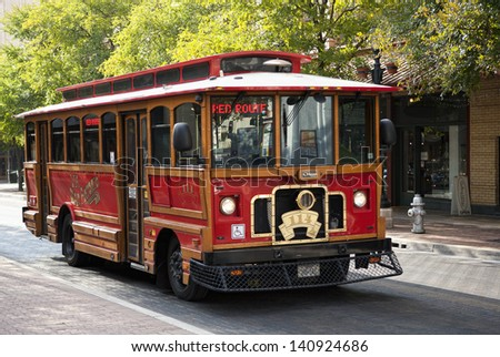 SAN ANTONIO, TEXAS - SEPTEMBER 15: Heritage street-car on Red Route, which runs along Houston, Alamo, Market st. etc. is used by tourists and locals, on September 15, 2011 in San Antonio, Texas USA.  - stock photo