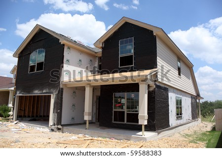 SAN ANTONIO, TX - AUGUST 19 : New home under construction in a down housing market on August 19, 2010 in San Antonio, TX - stock photo