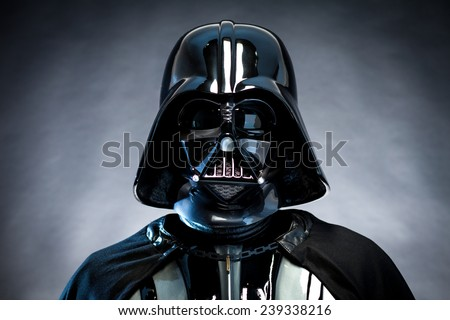 SAN BENEDETTO DEL TRONTO, ITALY. DECEMBER 5, 2014. Helmet of Darth Vader costume replica. Darth Vader or Dart Fener is a fictional character of Star Wars saga. Black background with grazing blue light - stock photo