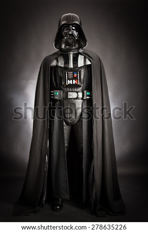 SAN BENEDETTO DEL TRONTO, ITALY. DECEMBER 5, 2014.Studio portrait of Dart Vader costume replica . Darth Vader or Dart Fener is a fictional character of Star Wars saga. Black background - stock photo