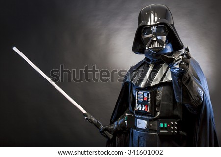SAN BENEDETTO DEL TRONTO, ITALY. MAY 16, 2015. Portrait of Darth Vader costume replica with grab hand and  sword . Lord Fener is a fictional character of Star Wars saga.  Blue grazing light  - stock photo