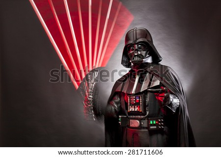 SAN BENEDETTO DEL TRONTO, ITALY. MAY 16, 2015. Stroboscopic photography of Darth Vader costume replica with grab hand and his sword .Studio photo,   Black background - stock photo