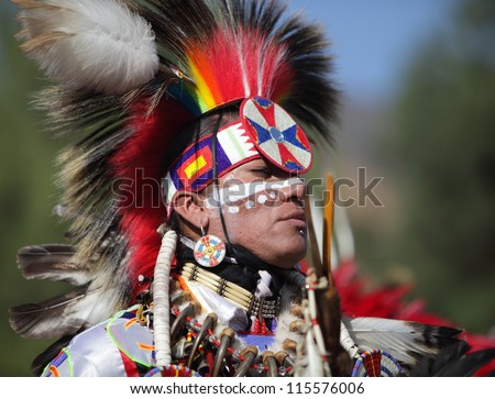 SAN BERNARDINO, CALIFORNIA, USA, OCTOBER 13, 2012.  The San Manuel Band of Indians hold their annual Pow Wow in San Bernardino on October 13, 2012. A tribal warrior wearing a Fancy Dancer head dress. - stock photo