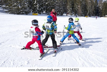 SAN CASSIANO, ITALY-MARCH 12, 2016: children ski school on the Dolomites mountains , in San Cassiano.