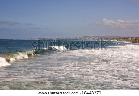 San Clemente Waves with Dana Point in the Background during a Surf Contest - stock photo