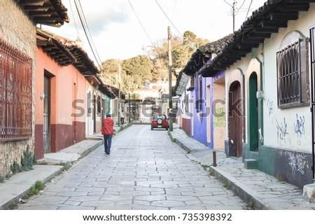 San Cristobal De Las Casas, Mexico - December 4, 2014: People are seen in the streets of the colonial town of San Cristobal De Las Casas on December 4, 2014