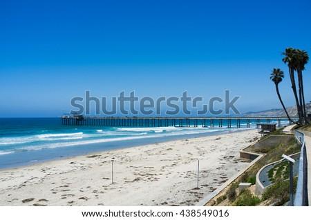 San Diego beach along coastline - La Jolla pier - University of California San Diego - stock photo