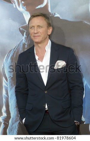 "SAN DIEGO, CA - JULY 23: Daniel Craig arrives at the world premiere of ""Cowboys and Aliens"" on July 23, 2011 at the Civic Theatre in San Diego, CA. - stock photo"