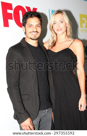 SAN DIEGO, CA - JULY 10: Nicholas Gonzalez and guest arrive at the 20th Century Fox/FX Comic Con party at the Andez hotel on July 10, 2015 in San Diego, CA. - stock photo