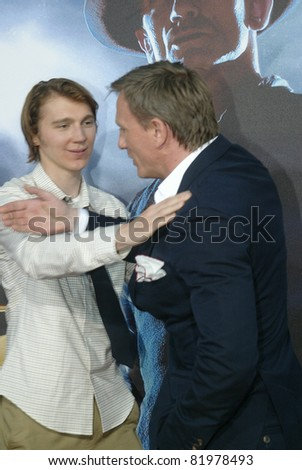 "SAN DIEGO, CA - JULY 23: Paul Dano and Daniel Craig arrive at the world premiere of ""Cowboys and Aliens"" on July 23, 2011 at the Civic Theatre in San Diego, CA. - stock photo"