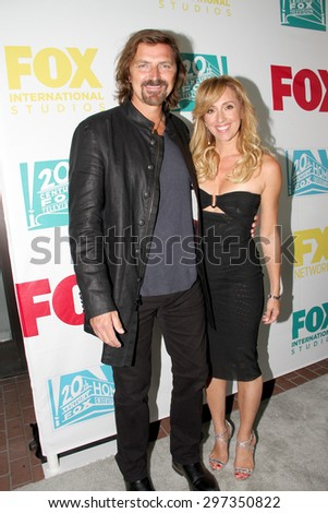 SAN DIEGO, CA - JULY 10: Robin Atkin Downes and Michael Ann Young  arrive at the 20th Century Fox/FX Comic Con party at the Andez hotel on July 10, 2015 in San Diego, CA. - stock photo