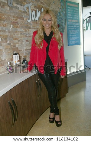 SAN DIEGO, CA - OCTOBER 19: Aubrey O'Day arrives for a meet and greet on October 19, 2012 at the 10th Grand Opening Celebration of Hollywood Tans salon in San Diego, CA.