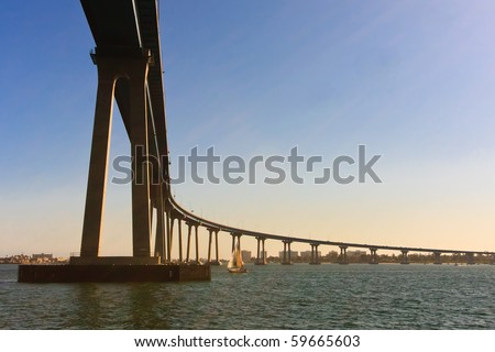 "San Diego - Coronado Bridge, locally referred to as the Coronado Bridge, is a concrete & steel"" bridge, crossing over San Diego Bay in the United States, linking San Diego, with Coronado, California. - stock photo"