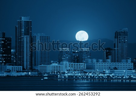 San Diego downtown skyline and full moon over water at night in BW - stock photo