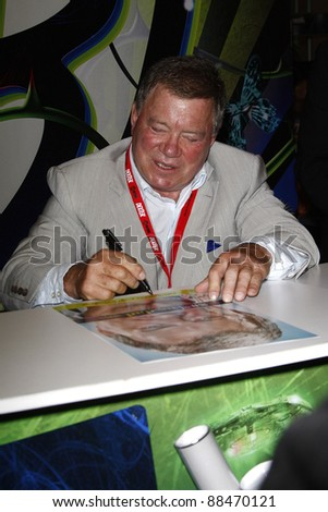 SAN DIEGO - JULY 23: William Shatner signs autographs during Day 2 of Comic-Con 2010 in San Diego, Californi on July 23, 2010 - stock photo