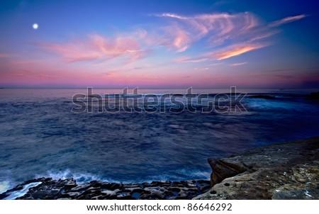 San Diego's La Jolla Shores and Moon in San Diego California at Dawn - stock photo