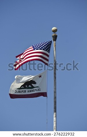 SAN DIEGO, USA - AUGUST 22 2013: American and California flags waving on the blue sky