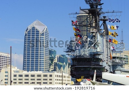 SAN DIEGO,USA - FEBRUARY 24 2014: The historic aircraft carrier, USS Midway commissioned after World War II, now a museum moored in Downtown San Diego, Southern California  - stock photo