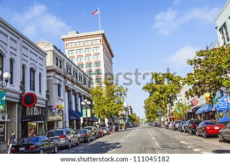 SAN DIEGO, USA - JUNE 11: facade of historic houses in the gaslamp quarter on June 11,2012 in San Diego, USA. The area is registered on the National Register of Historic Places and dates back to 1867. - stock photo