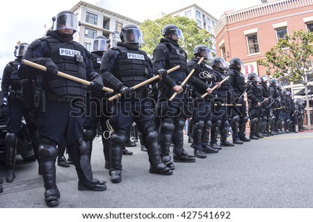 SAN DIEGO, USA - MAY 27, 2016: Riot police in full tactical gear stand ready to confront protesters at a Trump rally at the San Diego Convention Center - stock photo