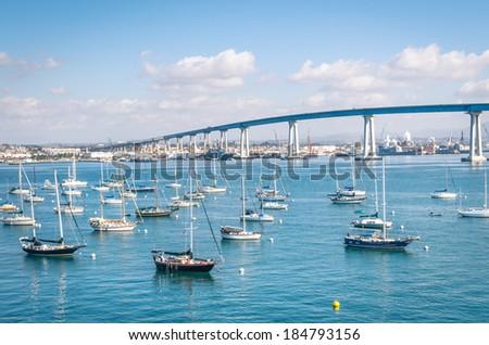 San Diego waterfront with sailing Boats - Industrial harbor and Coronado Bridge - stock photo