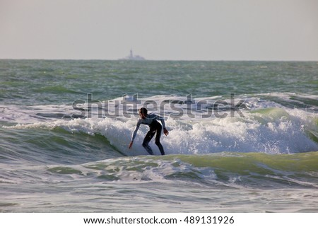 SAN FERNANDO, CADIZ, SPAIN - FEB 19: Unidentified surfer taking waves on the 2nd championship of Surf and BodyBoard Impoxibol on Feb 19,2011 on the beach of Camposoto of San Fernando, Cadiz, Spain
