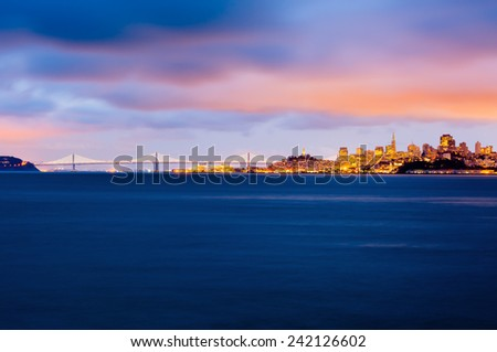 San Francisco and Bay Bridge at dusk - stock photo