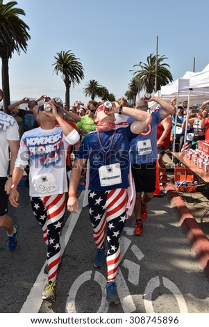 SAN FRANCISCO - AUGUST 22, 2015: Participants of the Beer Mile World Classic enjoy a beer per lap, four laps required to finish the race on August 22, 2015. - stock photo