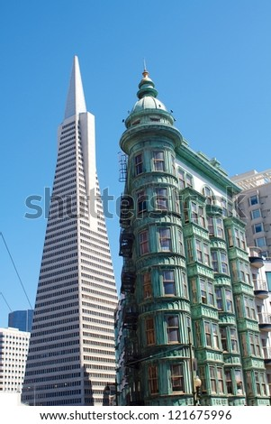 SAN FRANCISCO - AUGUST 11: Transamerica Pyramid (left) on August 11, 2012 in San Francisco. The Transamerica Pyramid is the tallest skyscraper in the San Francisco skyline and one of its most iconic. - stock photo