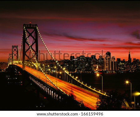San Francisco Bay Bridge and Skyline at Sunset - stock photo